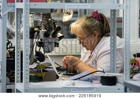 Zelenograd, Russia - October 19, 2017: Women Make Soldering Of Radio Components To Electronic Boards