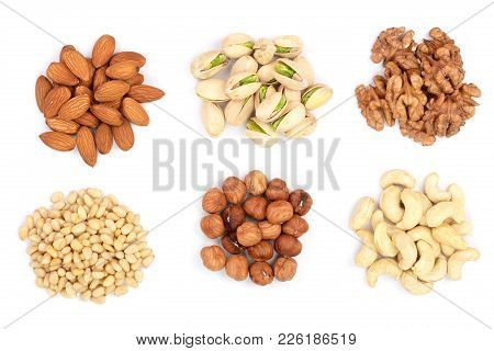 Mixed Of Nuts Heap Isolated On White Background. Almonds, Cashews, Hazelnuts, Pine Nuts And Walnuts.