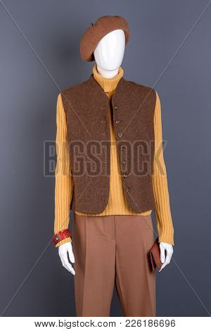 Beret, Waistcoat, Trousers On Female Mannequin. Women Yellow Turtleneck Sweater And Waistcoat. Dummy