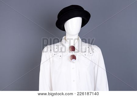 Mannequin In White Blouse And Black Hat. Women Stylish Shirt With Rhinestones. Female Fashion Clothe