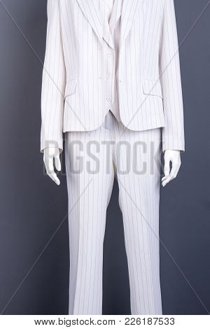 White Blazer And White Trousers For Women. Female Mannequin In White Formal Suit. Office Style Outfi