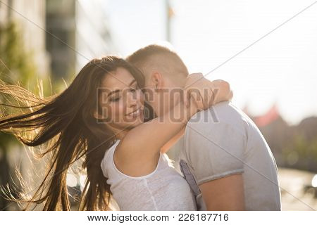Candid Shot Of Carefree Love Couple Hugging