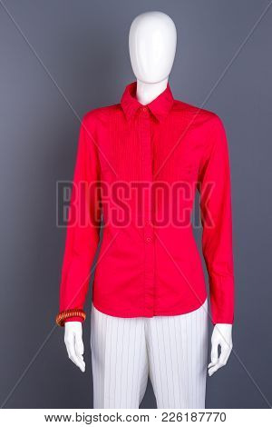 Red Fashionable Collar Blouse For Ladies. Female Mannequin Dressed In Red Elegant Shirt And White Tr