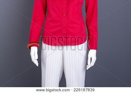Red Blouse And White Trousers For Women. Female Mannequin Dressed In Elegant Female Outfit. Dummy Wi