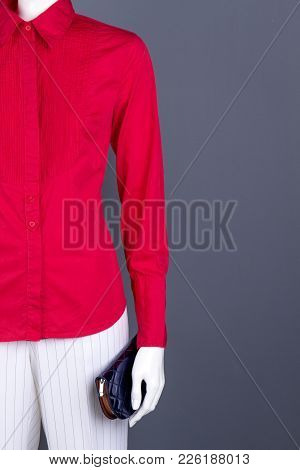 Mannequin In Women Clothing, Copy Space. Red Women Blouse, White Trousers And Wallet. Ladies Classy