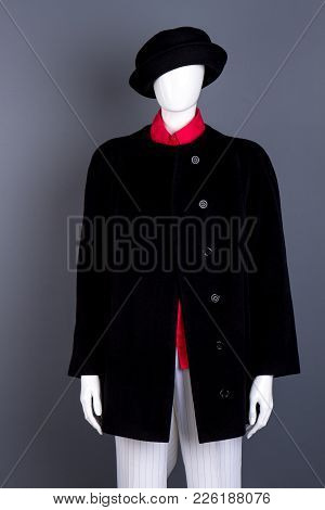 Female Mannequin Wearing Black Hat And Coat. Buttoned Overcoat For Women. Ladies Classy Clothes And