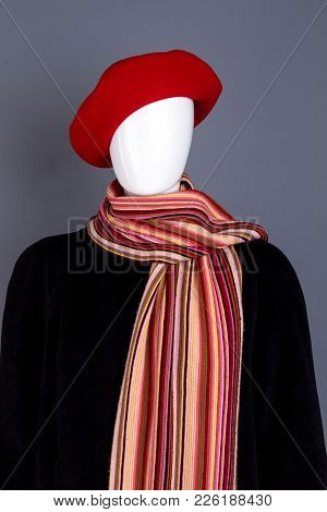 Red Beret, Scarf And Black Overcoat. Mannequin Wearing Red Women Headgear, Colorful Scarf And Coat.