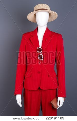 Female Mannequin In Elegant Red Attire. Mannequin With Women Red Jacket, Trousers, Sunglasses, Walle