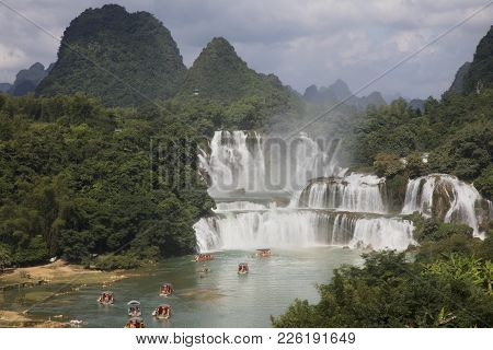 Tourist Boats Viewing Detian Waterfalls In China, Also Known As Ban Gioc In Vietnam Is The Fourth La
