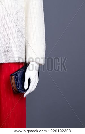 Female Mannequin With Wallet, Copy Space. Mannequin With Women White Sweater, Red Trousers And Blue