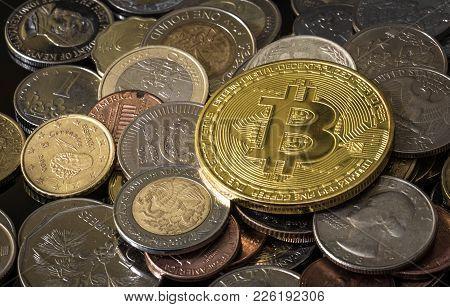 Golden Bitcoin Over A Pile Of Various Coins.