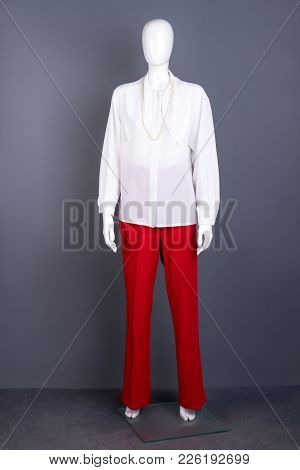 White Blouse And Red Trousers For Women. Full Length Female Mannequin Dressed In Elegant Long Sleeve