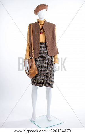 Ladies Classy Clothes And Accessories. Female Mannequin With Beret, Waistcoat, Skirt And Bag Isolate