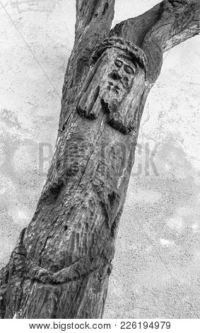 Wood Carved Statue Of Crucified Jesus Christ. Strange Artistic Statue.