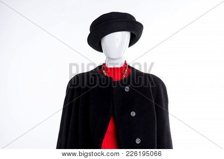 Female Mannequin In Black Hat And Coat. Women Autumn Apparel On Mannequin. Clothes For Stylish Ladie