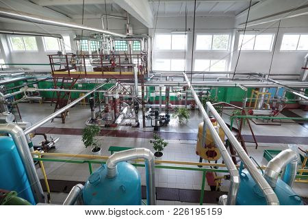 Modern Factory Boiler Room. Many Reservoirs, Pipelines, Pumps And Valves