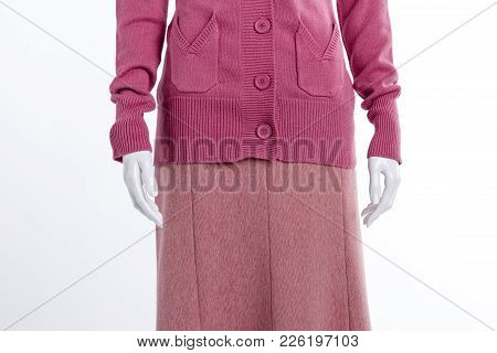 Close Up Casual Sweater And Skirt. Female Mannequin Dressed In Pink Cardigan With Pockets Close Up.