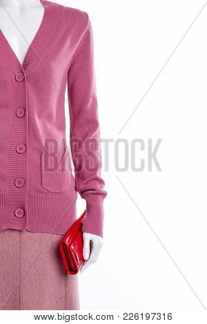 Mannequin With Red Wallet, Copy Space. Close Up Female Mannequin Dressed In Pink Buttoned Cardigan,