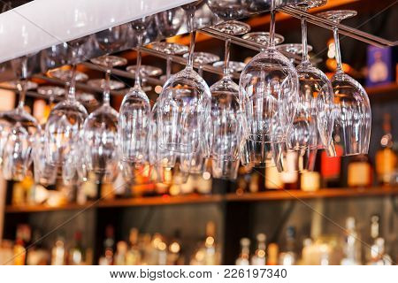 Different Glasses Hanging Over The Bar. Soft Focus. Selective Focus. Close Up
