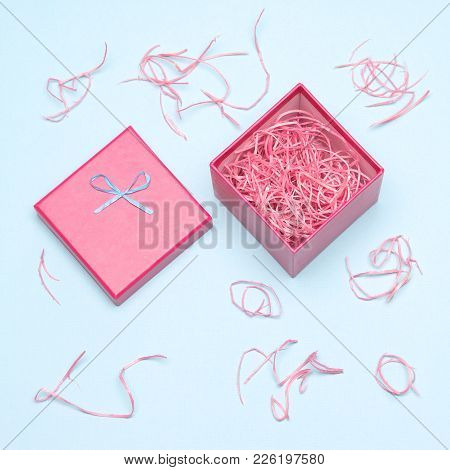 Gift Wrapping. Open Gift Box With Decorative Colored Shavings. Close-up, Top View