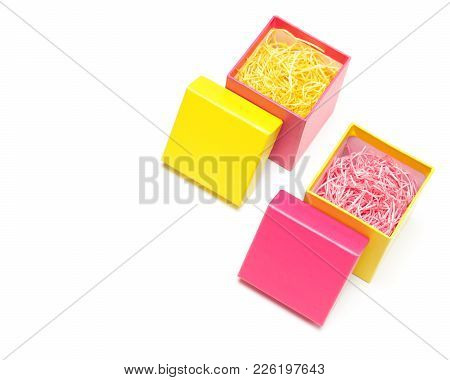 Two Open Colored Gift Boxes Filled With Decorative Shavings On White Background. Selective Focus, Co
