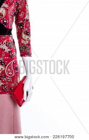 Red Blouse And Wallet, Copy Space. Female Mannequin Dressed In Sweatshirt And Skirt, Cropped Image.
