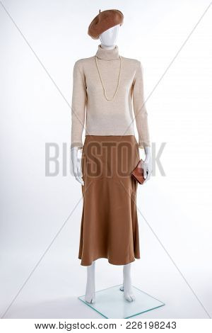 Beige Sweater And Brown Skirt. Brown Beret And Turtleneck Sweater On Female Mannequin. Ladies Casual