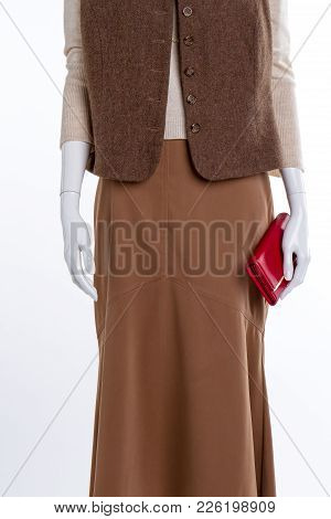 Female Waistcoat, Skirt And Wallet. Long Brown Skirt And Red Leather Purse Close Up, Cropped Image.