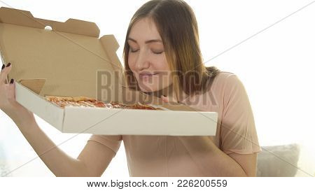 Happy Young Woman With Hot Pizza