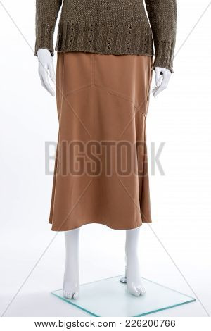 Brown Casual Skirt For Women. Female Mannequin Dressed In Warm Knitted Pullover And Skirt, Cropped I