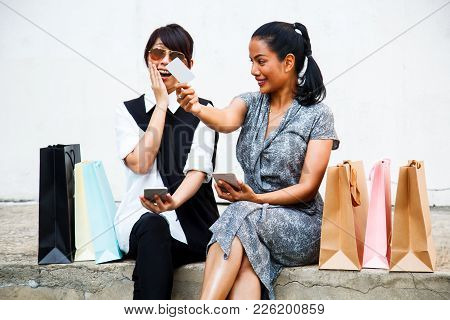 Smiling Female Ladies Shopping Concept With Digital Technology. Asian Buddy Female Shoppers Happy Sh