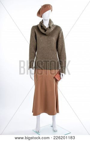 Brown Beret And Skirt On Female Mannequin. Beret, Turtleneck Sweater, Skirt And Wallet For Women. Wo
