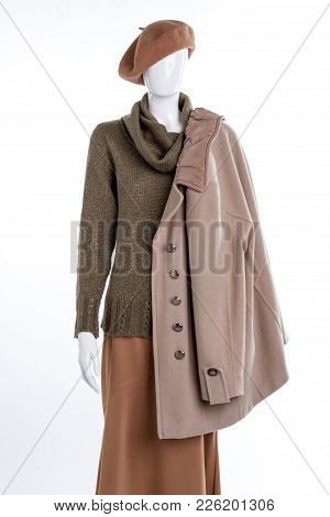 Beige Cashmere Coat For Women. Female Mannequin With Headgear, Sweater, Skirt And Overcoat. Collecti
