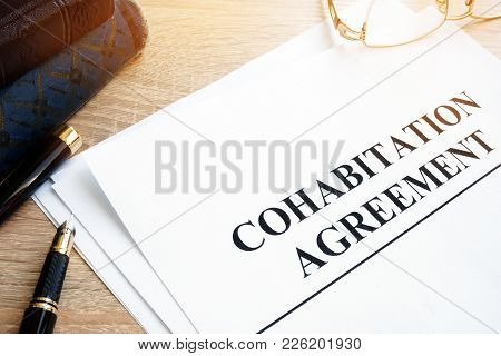 Cohabitation Agreement And Book On A Table.