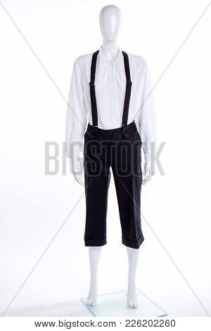 White Shirt And Black Trousers With Suspenders. Female Mannequin Dressed In Blouse And Capri With Br