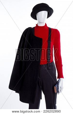 Black Hat And Overcoat For Women. Red Sweater And Black Trousers With Suspenders. Life And Style.