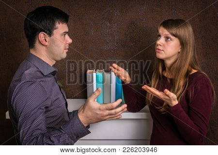 Unhappy Couple Having Argument At Home - Family Quarrel Concept