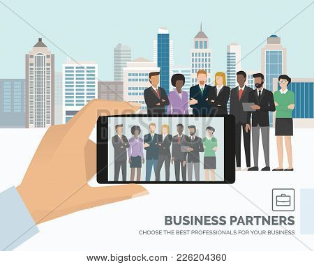 Corporate Multi Ethnic Business People Posing Together And City Skyline On The Background, A Man Is