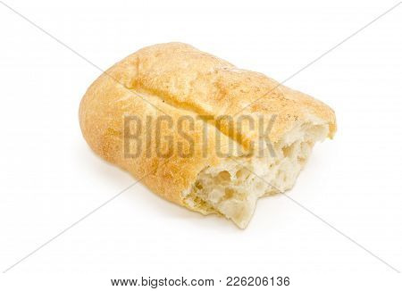 Broken Piece Of Loaf Of The Fresh Ciabatta On A White Background