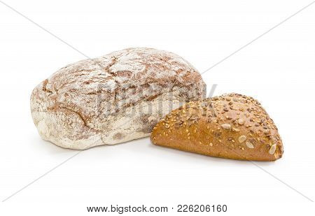 Whole Loaves Of The Multigrain Dark Brown Bread With Molasses And Small Triangular Shaped Bread Spri