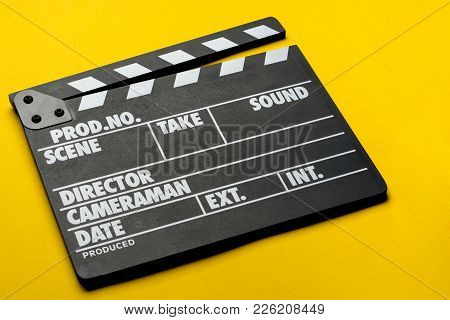 Movie Clapper On Yellow Background, Cinema Concept.