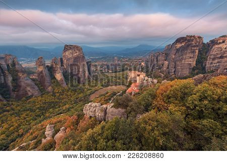 Morning View Of Beautiful Meteora, Greece. Cinematic View On Unusual Rock Formations And Monastery O