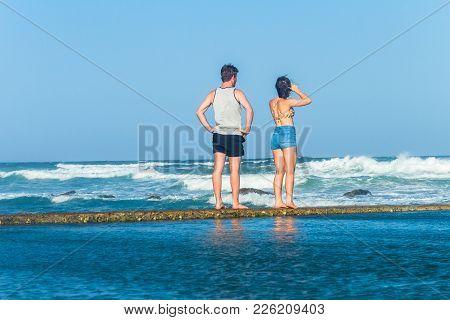 Girl Teenager Exploring Beach Ocean Tidal Swimming Pool Waves Holiday Landscape.