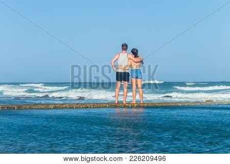 Girl Boy Teenager Exploring Beach Ocean Tidal Swimming Pool Waves Holiday Landscape.