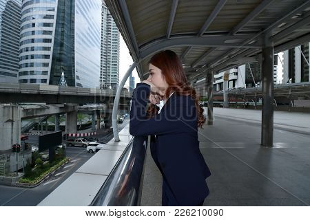 Wide Angle Shot Of Stressed Frustrated Young Asian Business Woman  Feeling Tired Or Disappointment A