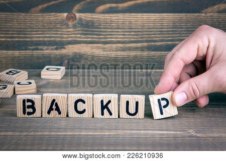 Backup. Wooden Letters On The Office Desk, Informative And Communication Background.