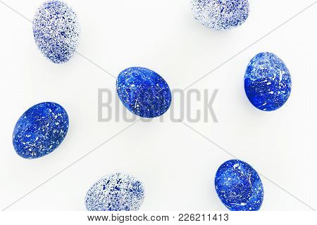 Speckled Easter Blue Eggs Isolated On White Background. Flat Lay. Top View