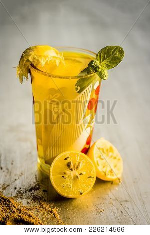 Limbo Sharbat,lemon Juice Or Citrus × Limon Juice With Some Leaves Of Mint In A Transparent Glass.