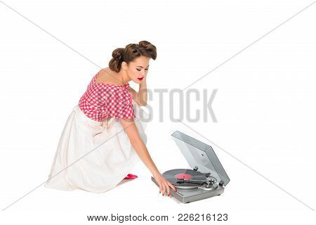Woman In Pin Up Style Clothing Listening To Phonograph Isolated On White
