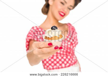 Selective Focus Of Woman In Pin Up Clothing Showing Cupcake Isolated On White